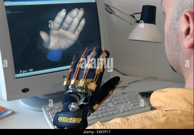Advanced School St.Anna of Pisa (Italy), Laboratory PERCRO,  research on virtual reality; glove for virtual reality - Stock Image