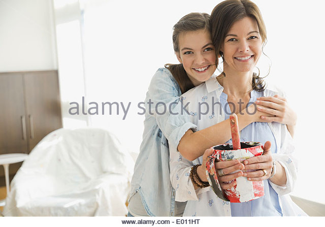 Portrait of mother and daughter preparing to paint - Stock Image