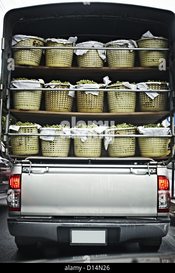 Truck carrying bins of fruit - Stock Image