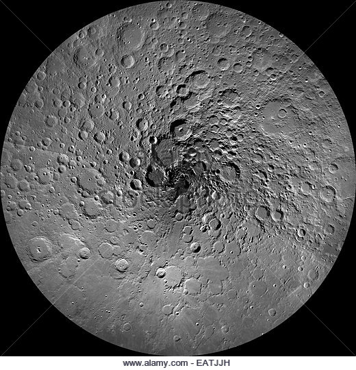 Shadows darken craters at the moon's north pole. - Stock-Bilder