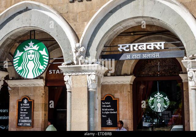 Mumbai India Indian Asian Fort Mumbai Kala Ghoda Veer Nariman Road Elphinstone Building Starbucks Coffee cafe outside - Stock Image