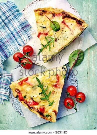 Quiche with cherry tomatoes - Stock Image