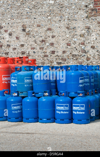 Stacked CALOR GAS butane bottles / cylinders / canisters - Stock Image
