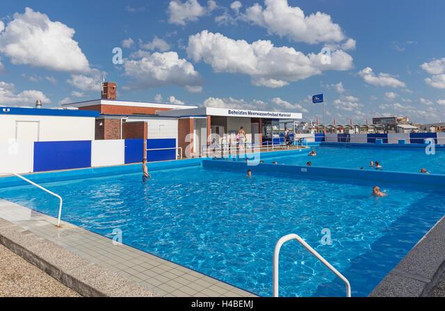 Sea water pool bathers stock photos sea water pool for Heated garden swimming pools