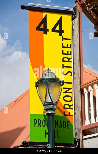 Philipsburg Front Street name banner and street lamp light St Maarten - Stock Image