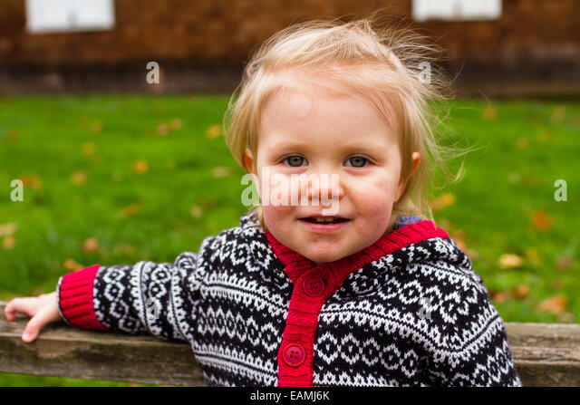 Lifestyle portrait of a young one year old child outdoors. - Stock Image