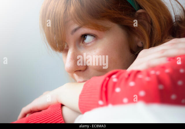 Cute hipster girl daydreaming, closeup photo - Stock Image