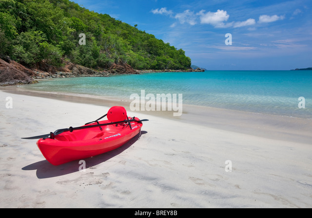 Red canoe at Megan's Bay. St. Thomas. US Virgin Islands. - Stock Image