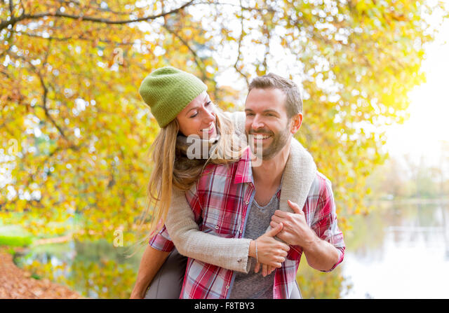 Young couple dating in forest - Stock-Bilder