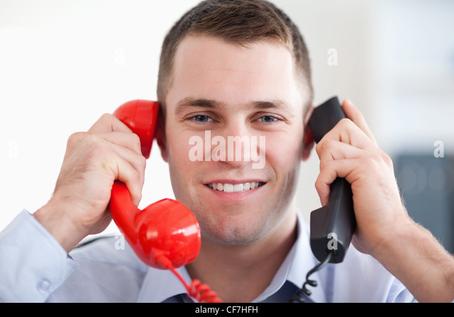 Close up handling the telephone stress smiling - Stock Image