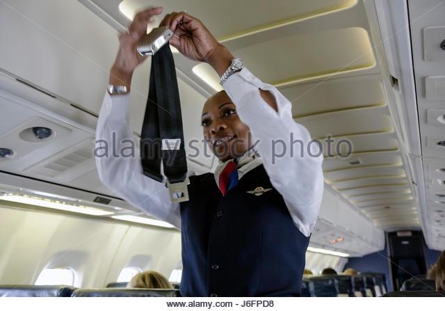 Atlanta Georgia Hartsfield International Airport Delta Airlines Black woman airline flight attendant aircraft safety - Stock Image