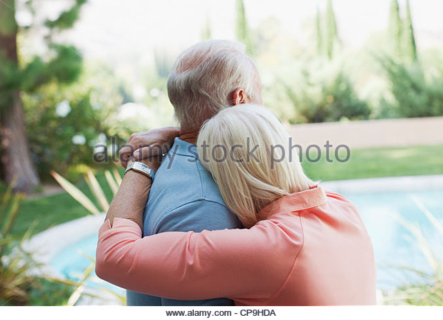 60-64 years,65-69 years,affection,aging,bonding,california,casual clothing,caucasian,color image,comforting,day,domestic - Stock Image