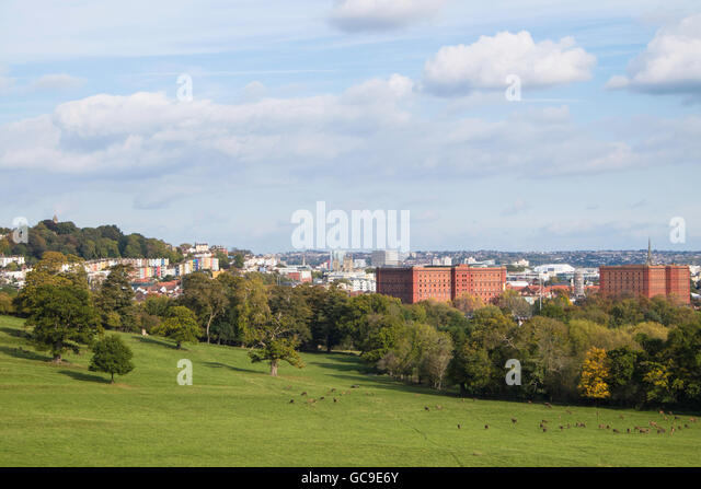 Bristol skyline view taken from the Ashton Court deer park showing the former tobacco warehouses, green parkland - Stock Image