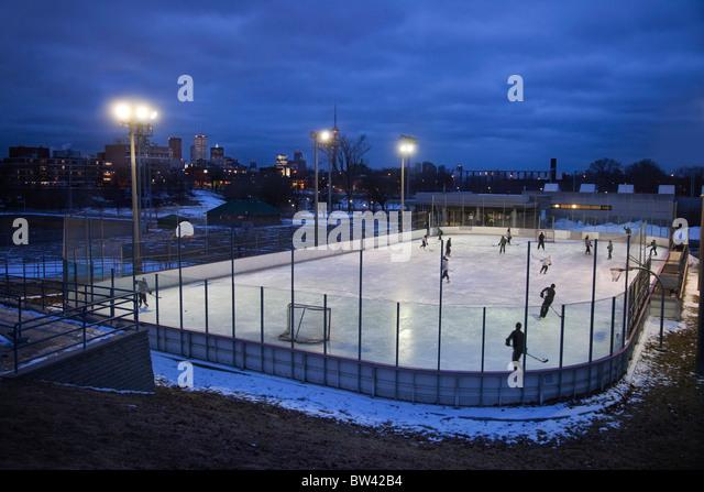 Evening skate on community skating rink, Toronto, Ontario, Canada - Stock Image