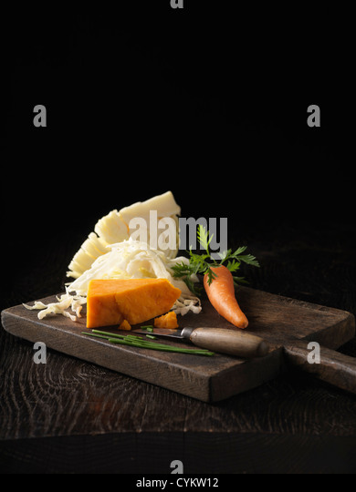Onion, carrot and cabbage on board - Stock Image
