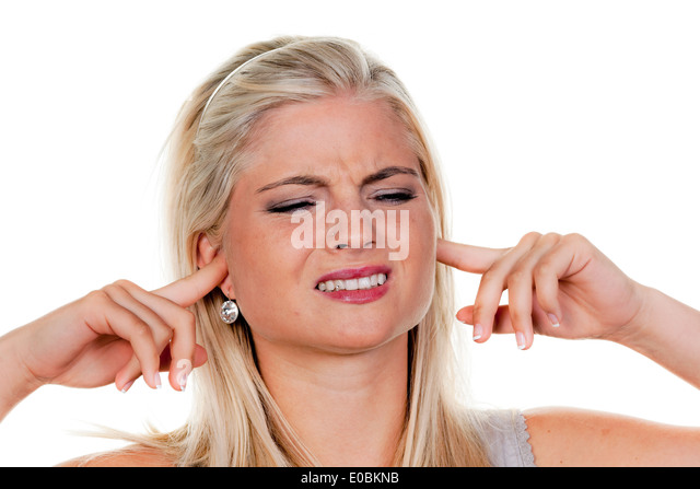 woman suffers from noise pollution, keeps closed to herself the ears - Stock Image