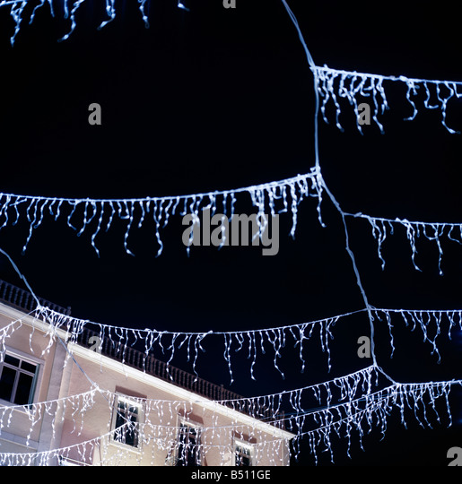 Low angle view of decorating lights hanging in a street Setubal Lisboa Region Portugal - Stock-Bilder