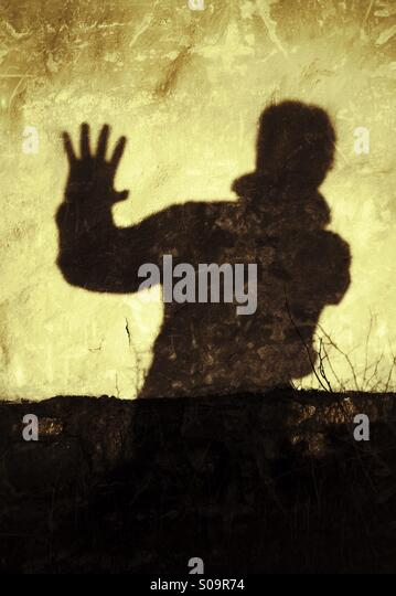 Stop! No more! Man casting a shadow on a wall expressing, Stop!, No more! - Stock-Bilder