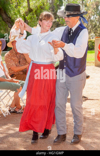 Dressed as old time Spanish Californians, a dance teacher and student perform a historical Spanish colonial dance - Stock Image