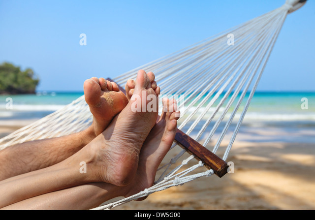 happy couple on the beach in honeymoon - Stock Image
