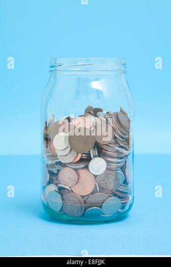 Glass Jar of coins - Stock Image