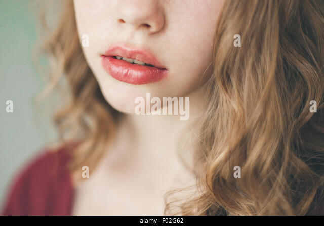 Close-up of a young woman wearing lipstick - Stock Image
