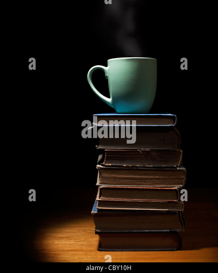 Coffee cup on Stack of books - Stock Image