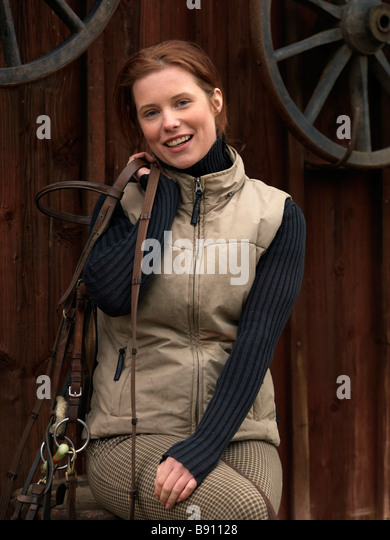 A woman crazy about horses Sweden. - Stock Image