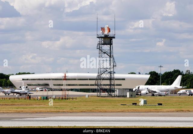 Radar Tower and TAG Aviation Terminal, London Farnborough Airport, Farnborough, Hampshire, UK. - Stock Image