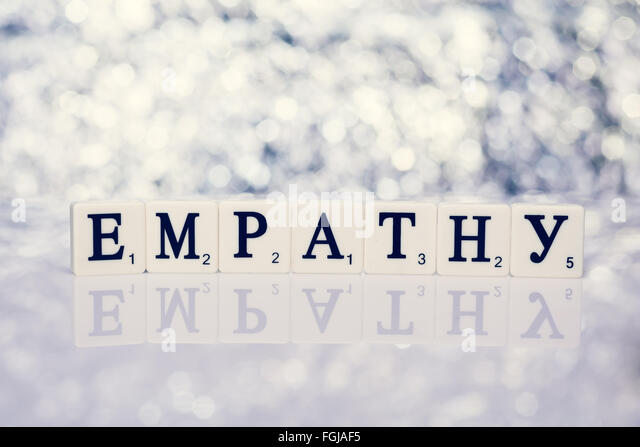 Written word tiles with letters from the game Scrabble - empathy - Stock Image