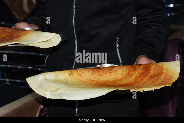 Masala Dosa served in a South Indian restaurant. - Stock Image