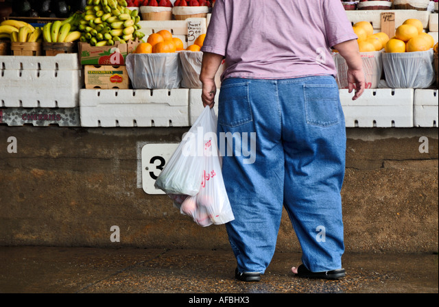 heavy woman at fruit stand - Stock-Bilder