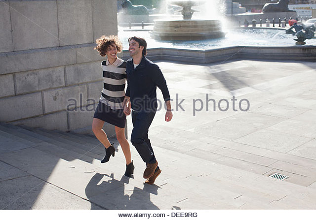 Couple walking in London - Stock Image