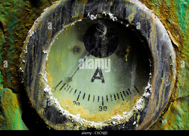 Rusty amperage meter of an abandoned power station - Stock Image