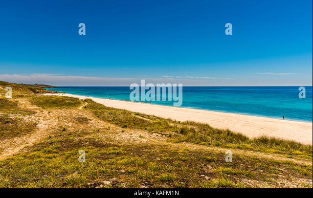 Sandy beach and blue skies near Plouhinec, Brittany, France - Stock Image