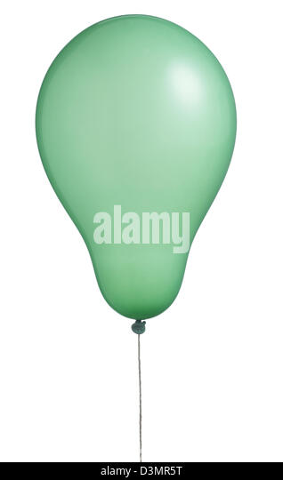 a single green helium balloon floating on a string isolated on white with clipping path - Stock Image