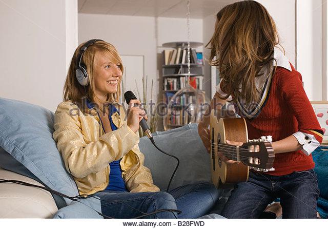 Two teenage girls making music - Stock-Bilder