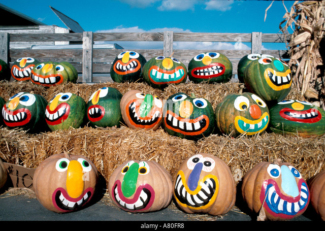 Halloween pumpkins painted faces Fall autumn - Stock Image