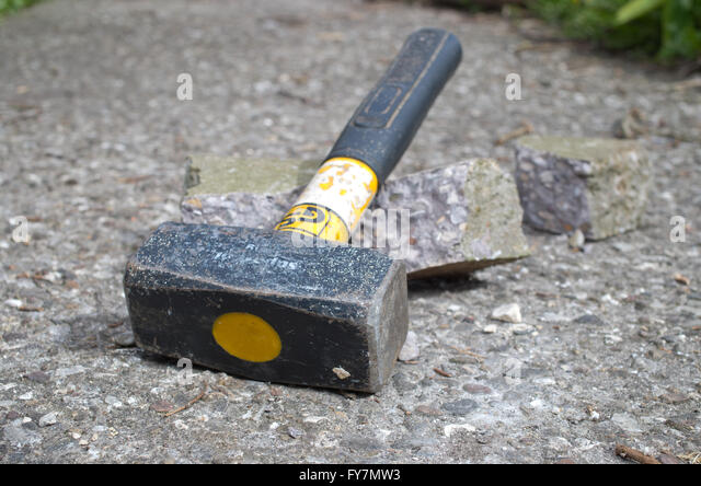 Lump hammer used to break up concrete - Stock Image