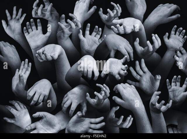 Close-up of hands reaching out - Stock Image