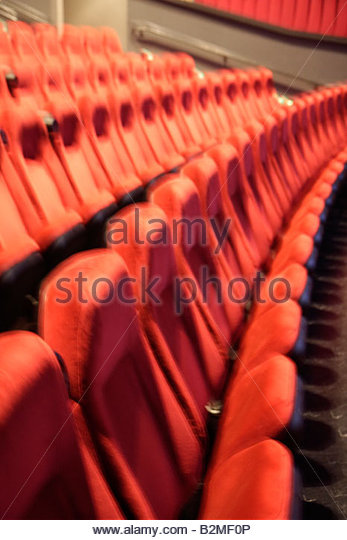 Indiana Portage Portage 16 IMAX movie theater complex red chair seating row empty folding blurred - Stock Image