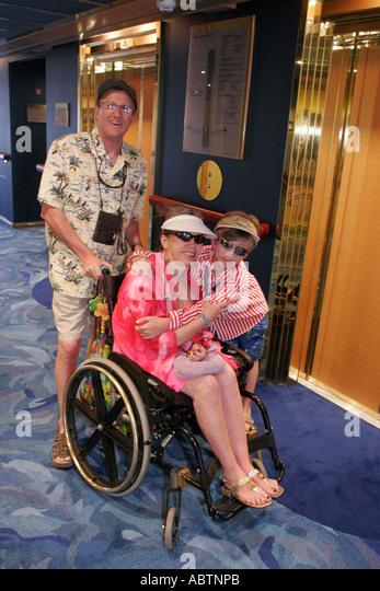 St. Thomas USVI Holland America Line ms Noordam lobby family wheelchair mother - Stock Image