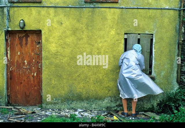 countrywoman at the frontdoor ireland - Stock Image