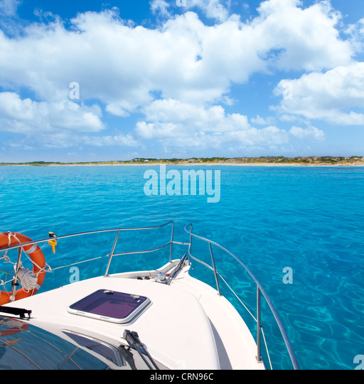 Boat in Formentera island transparent water on llevant beach - Stock Image