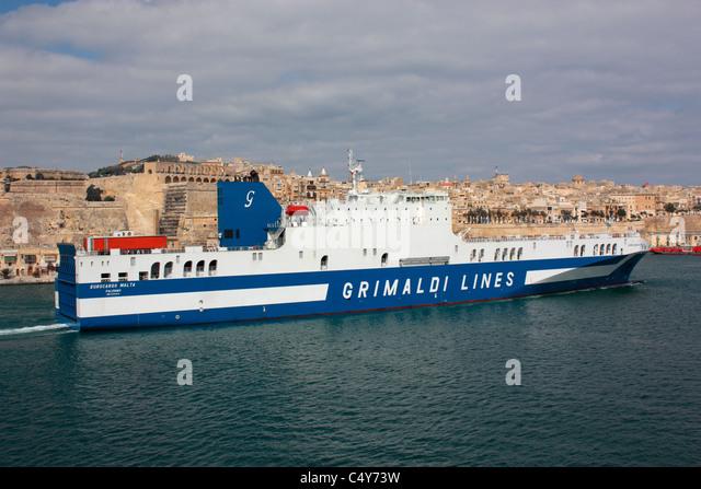 Sea transport. The Grimaldi Lines ro-ro vessel Eurocargo Malta departing from Malta's Grand Harbour - Stock Image