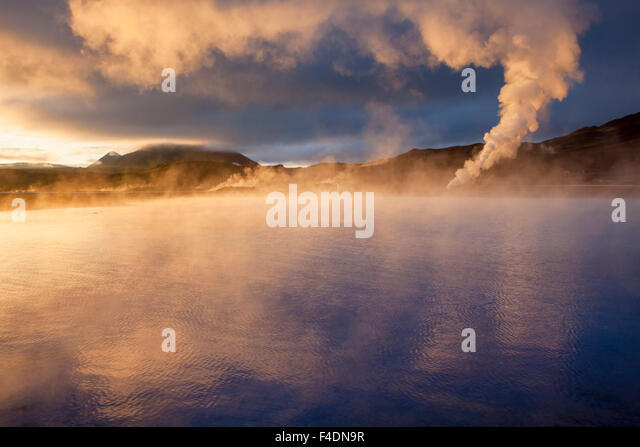 Sunset light on the streaming geothermal vents at Bjarnarflag, Myvatn, Nordhurland Eystra, Iceland. - Stock Image