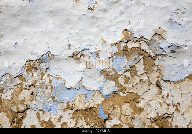 detail of old mud coating on the village house - Stock Image