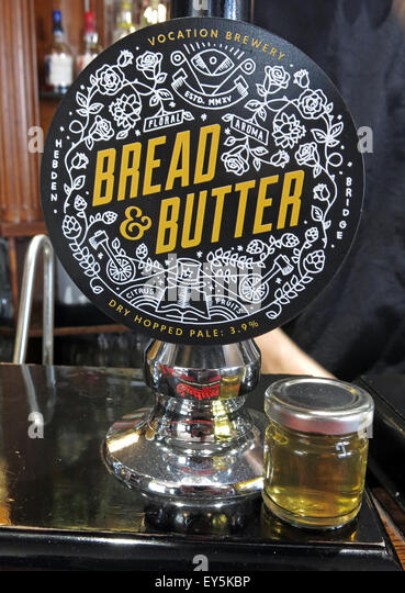 Bread and Butter Real Ale with taster bottle to show light colour - Stock Image