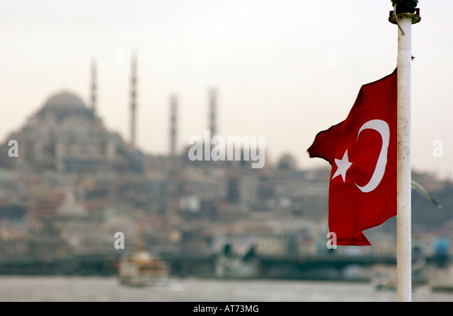 The Turkish flag seen against part of the Istanbul skyline. - Stock-Bilder