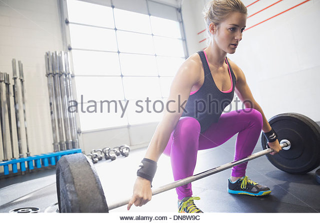 Woman practicing deadlifts - Stock Image